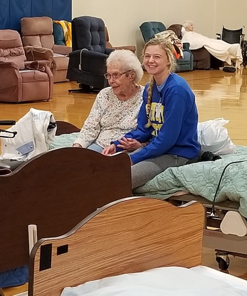Resident Elsie Wiese and Bethel staff member Kendra Leighton during evacution at CC